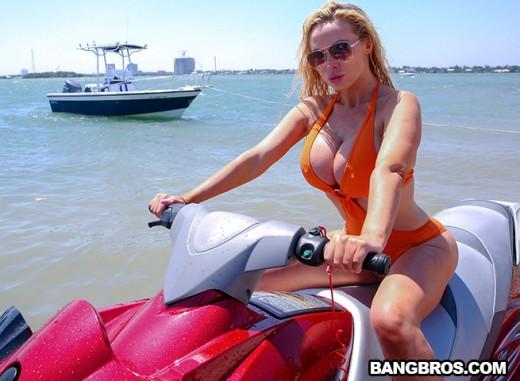 Nikki Benz in sexy orange one piece swimsuit on a jet ski at Bangbros Clips