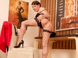 Karen Wood in fishnet stockings for Anilos