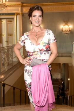 mature celebrity Katarina Witt with nice cleavage
