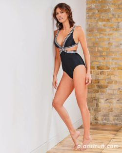 celebrity Melanie Sykes in black swimsuit
